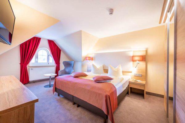Schlafzimmer der Suite im Centralhotel Binz auf der Insel Rügen