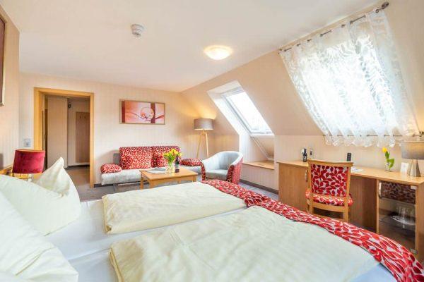 Schlafzimmer der Luxus-Apartment-Suite im Centralhotel Binz auf Rügen